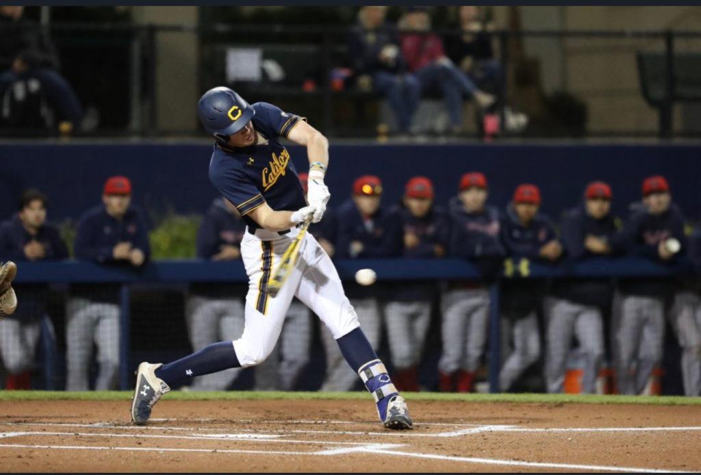 Alumni 8 Holman hitting